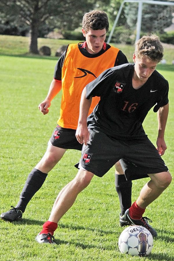 Juniors Mason Stetler and Austin Urban battle during practice