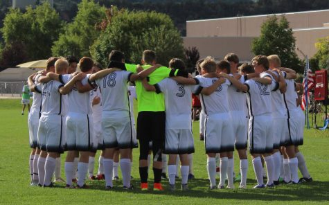 The Varsity boys team gathers for a pre-game pump up.