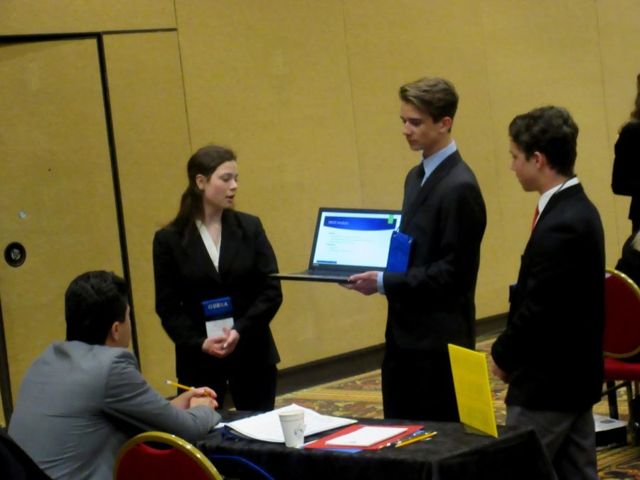 Durango+DECA+members+Caroline+Knight%2C+Logan+Fullington%2C+and+Jack+Beatie+present+their+written+project+at+state.